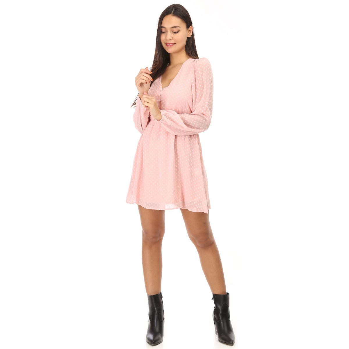 Robe rose à pois et transparence